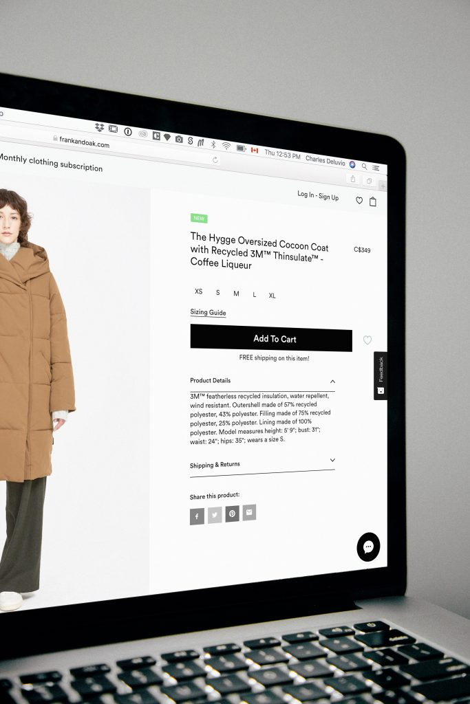 Example of shopping online for a coat on a MacBook. Photo Credit: Charles