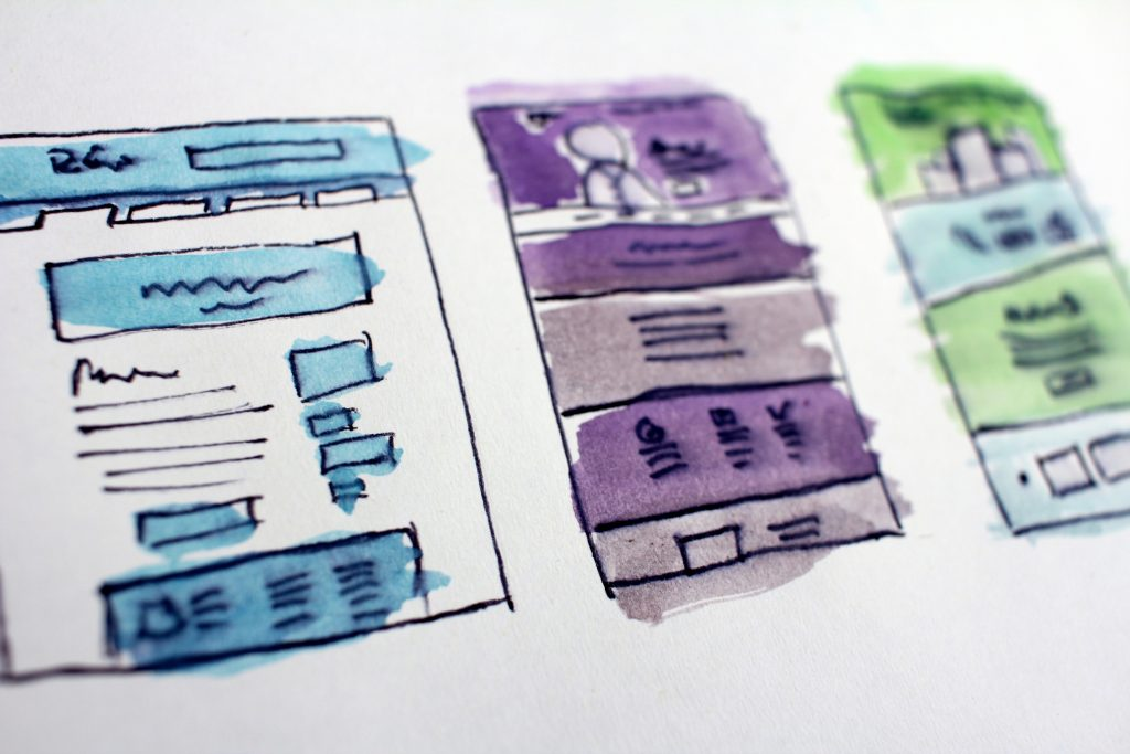 A blue, purple, and green web design sketch for a website | Photo Credit: Hal Gatewood
